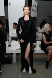Whitney Port layered a textured black blazer over a maxi dress for the Misha Collection fashion show.
