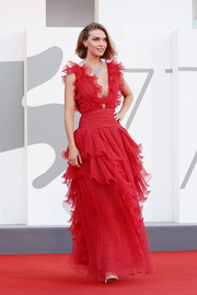 Arizona Muse looked oh-so-romantic in a ruffled red gown by Alberta Ferretti at the Venice Film Festival screening of 'Miss Marx.'
