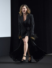 Rebecca Ferguson complemented her coat with a pair of chunky platforms by Laurence Dacade.