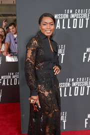 Angela Bassett teamed a black and gold box clutch with a sheer dress for the US premiere of 'Mission: Impossible — Fallout.'