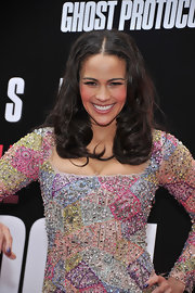Paula Patton wore her hair in long loose curls with a distinct center part at the US premiere of 'Mission: Impossible - Ghost Protocol.'