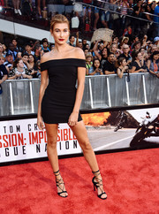 Hailey Baldwin flaunted her figure in a tight black off-the-shoulder mini by Elizabeth and James during the New York premiere of 'Mission: Impossible - Rogue Nation.'
