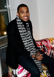 Chris Brown looked cozy in a stylish black and white scarf as he attended an event for the newly debuted Menswear Collection of Missoni.