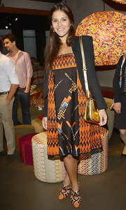 A metallic gold shoulder bag added some shimmer to Margherita Missoni's ensemble at the Luci e Ombre cocktail party.