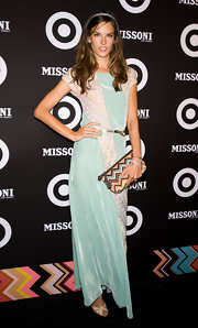 Alessandra donned a pretty sea-foam green maxi dress for the Missoni for Target launch party in NYC. She accessorized the look with a chevron-print clutch.