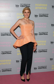 Greta Gerwig chose tapered black slacks to pair with her ultra-girly top.