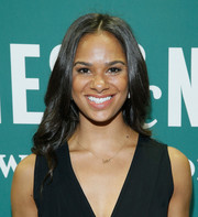 Misty Copeland attended her book signing wearing a gently wavy, center-parted hairstyle.