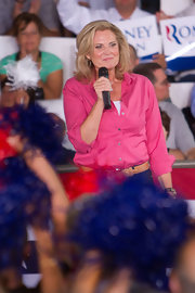 Ann looked cheery in this hot pink button-down shirt and belted jeans.