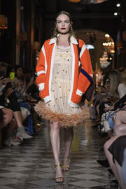An orange and white cardigan topped off Kate Bosworth's runway look.