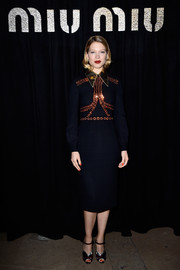 Lea Seydoux looked adorably vintage-chic at the Miu Miu fashion show in a navy dress with a beaded bodice and a metallic, pointy collar.