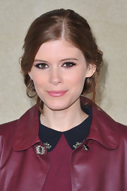Kate Mara swept back her hair into a pretty, romantic updo for the Miu Miu fall 2012 fashion show.