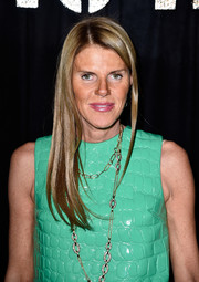 Anna dello Russo showed off a sleek and chic hairstyle at the Miu Miu fashion show.