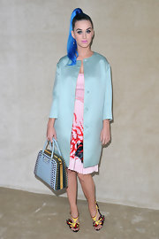 Katy Perry accessorized her pink pleated dress with trendy flame-inspired heels.