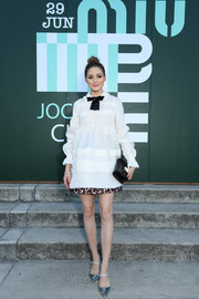 For her bag, Olivia Palermo chose an elegant croc-embossed patent clutch.