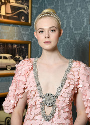 Elle Fanning had a princess moment at the Miu Miu Cruise show when she wore this elegant pearl headband.