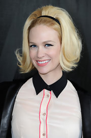 A soft pink lip topped off January Jones' '60s-inspired look at the Miu Miu runway show in Paris.