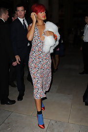 Rihanna paired her red satin pumps with blue sheer socks from the Resort 2011 collection.
