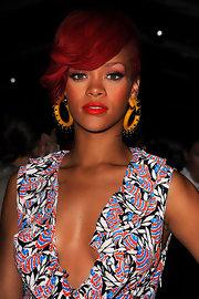 Rihanna spiced up her vibrant red locks with yellow hoop earrings from the Resort 2011 collection.