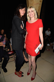Not surprisingly, Emmanuelle Alt was wearing black when she attended the Miu Miu show, but those red cap-toe pumps added a welcome splash of color.