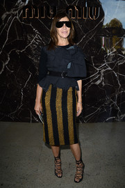 Carine Roitfeld paired a boldly striped pencil skirt with a deconstructed-chic blouse for the Miu Miu fashion show.