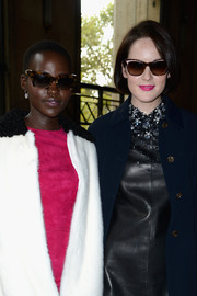Michelle Dockery arrived for the Miu Miu Spring 2014 show wearing a pair of cateye sunnies.