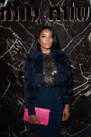 Gabrielle Union contrasted her all-blue outfit with a bright pink leather clutch when she attended the Miu Miu fashion show.
