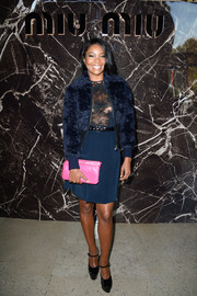 A blue fur jacket provided a fun finish to Gabrielle Union's cocktail dress at the Miu Miu fashion show.
