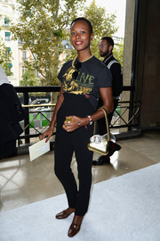 Shala Monroque went for a dressed-down look with a pair of high-waist black pants and a Bob Marley T-shirt when she attended the Miu Miu fashion show.