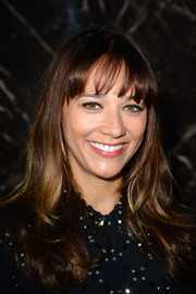 Rashida Jones sported a youthful vibe with her long curls and wispy bangs at the Miu Miu fashion show.