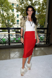Angie Harmon looked sexy-sporty at the Miu Miu fashion show in a red pencil skirt and a snakeskin-print track jacket.