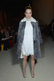 Lea Seydoux was retro-glam in a gray Miu Miu fur coat layered over a white lace dress during the brand's fashion show.