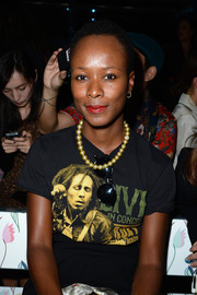 Shala Monroque dolled up her Bob Marley tee with a strand of pearls when she attended the Miu Miu fashion show.