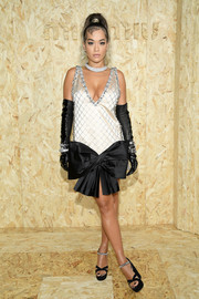 Rita Ora sealed off her look with a pair of crystal-adorned platform sandals, also by Miu Miu.