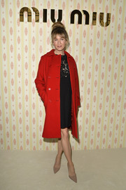 Renee Zellweger's red Miu Miu coat and lace LBD were a very elegant pairing.