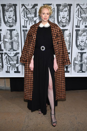 Gwendoline Christie topped off her dress with a tan houndstooth coat.