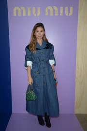 Miroslava Duma rocked a denim trenchcoat by Miu Miu during the label's Spring 2017 show.