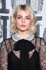 Lucy Boynton looked adorable with her short, messy waves at the Miu Miu Fall 2018 show.