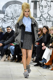 Georgia May Jagger hit the Miu Miu catwalk wearing a bulky tweed and leather jacket over a pastel-blue button-down.