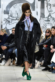 Kaia Gerber was edgy-glam in a black tweed and leather coat while walking the Miu Miu runway.
