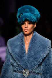 Joan Smalls strutted down the Miu Miu runway wearing a furry blue newsboy cap.