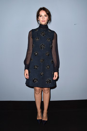 Felicity Jones brought a '60s vibe to the 'Miu Miu Women's Tales #7 - #8' premiere with this high-neck, beaded navy frock.