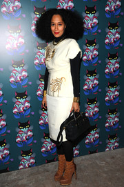 Tracee Ellis Ross accessorized her outfit with a stylish black cross-body tote.