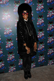 June Ambrose showed off her unique style with this sequined jacket, fur hat, and oversized sunnies combo at the 'Spark & Light' screening.