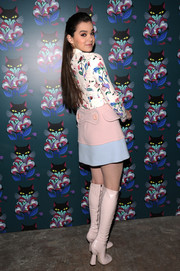 Hailee Steinfeld went for a '60s vibe with a pink and blue mini skirt and a pair of knee-high boots.