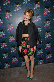 Bella Thorne finished off her outfit in quirky style with a pair of music note-print pumps by Miu Miu.