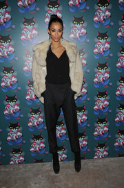 Anais Mali glammed up her casual blouse and pants combo with an ecru fur jacket.