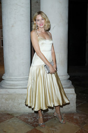 Naomi Watts was vintage-chic in a champagne satin dress with embellished shoulder straps at the 'Women's Tales' dinner.