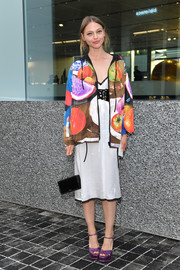 Sasha Pivovarova added an extra pop of color with a pair of purple platform sandals.