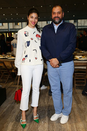 Caroline Issa attended the Prada private dinner wearing a cute portrait-print blouse.