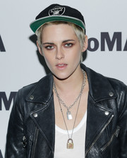 Kristen Stewart showed off her tough-girl style with this Raiders cap and leather jacket combo at the MoMA screening of 'Come Swim.'